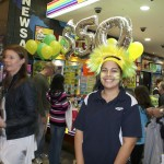 Cassie sporting the green and yellow for Oz Lotto's $50 Million jackpot.